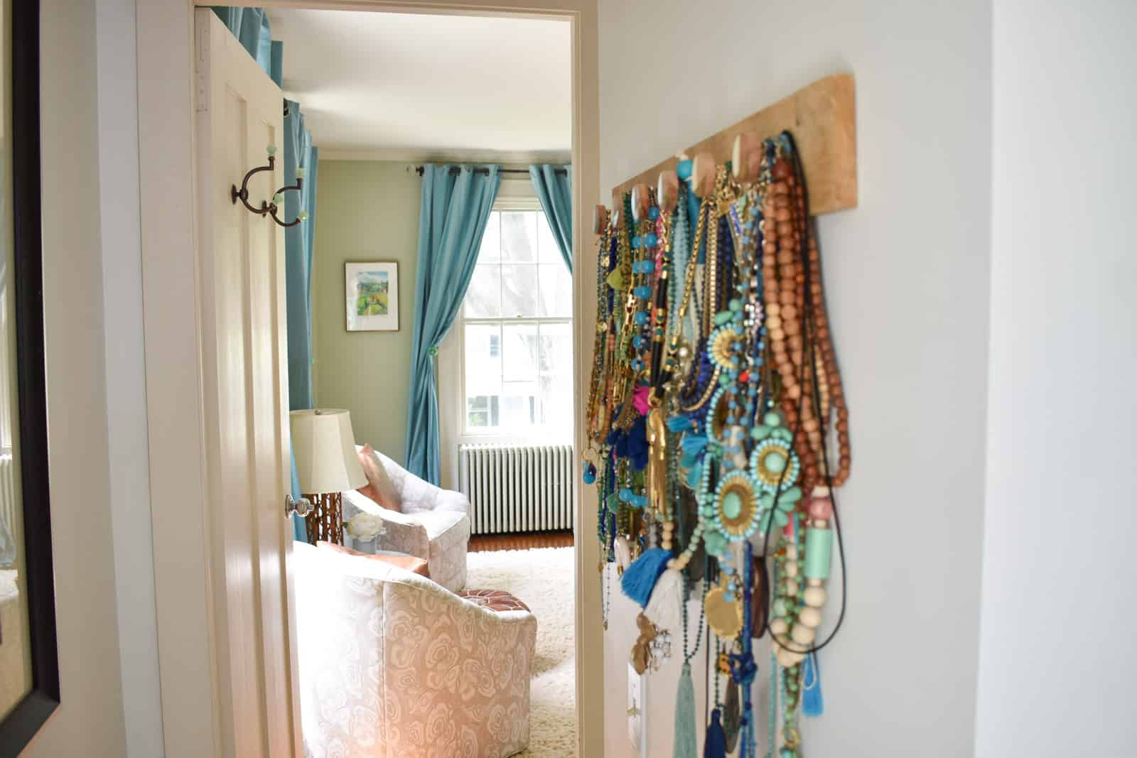jewelry hanging on hooks before