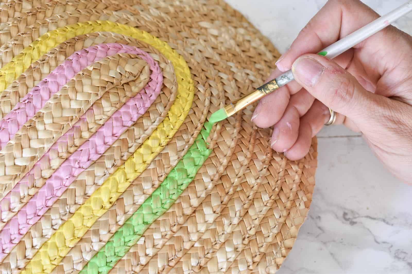 painting the straw clutch with rainbow colors