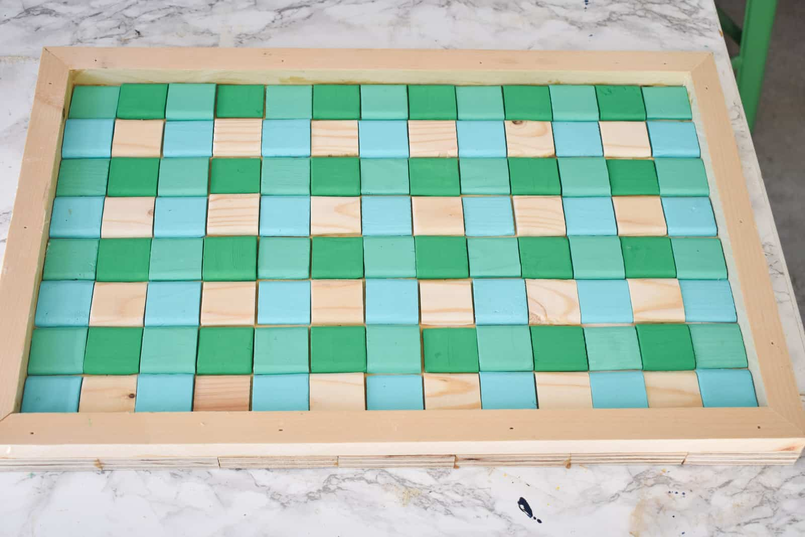 Glue the squares onto tray