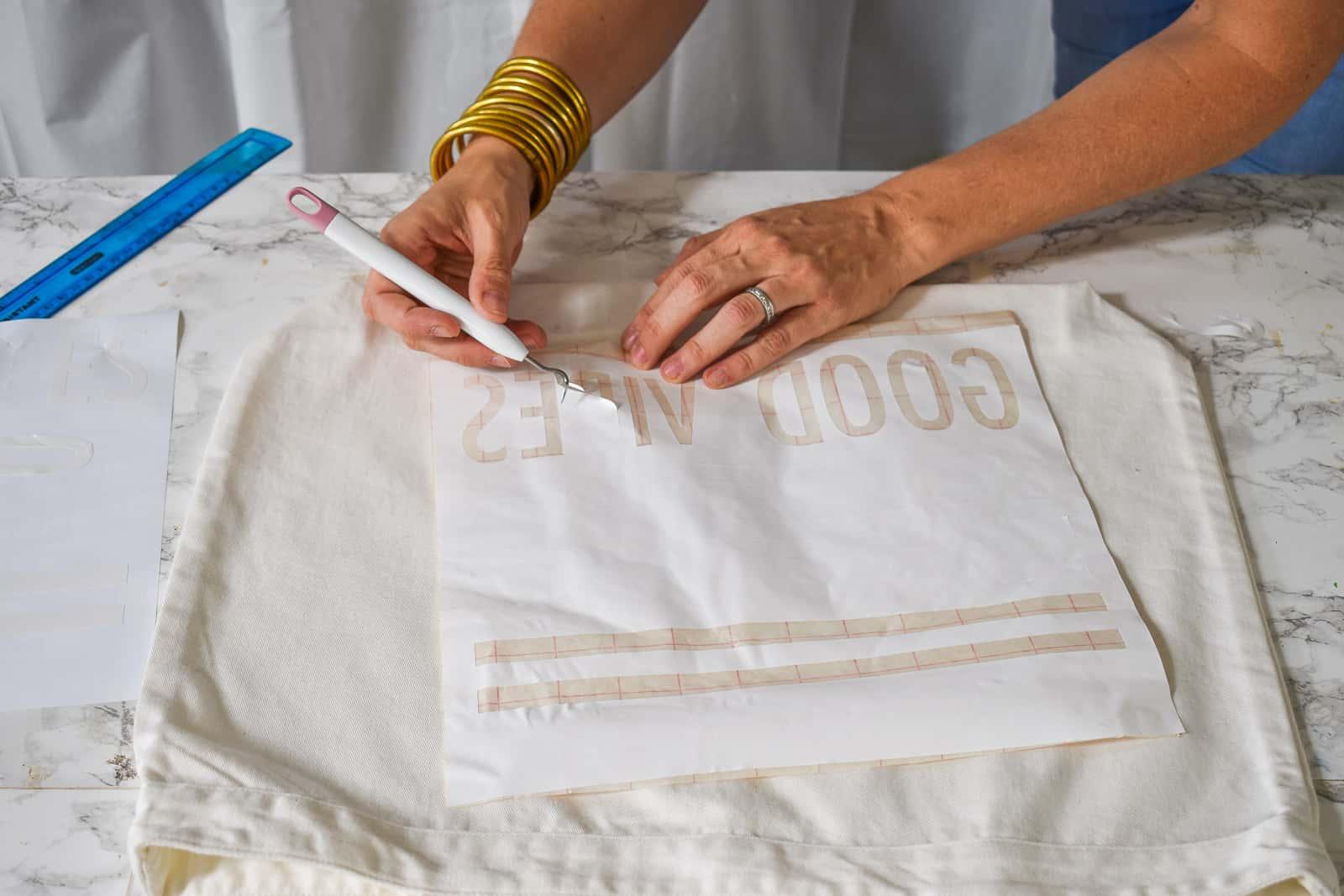 remove vinyl scraps from stencil