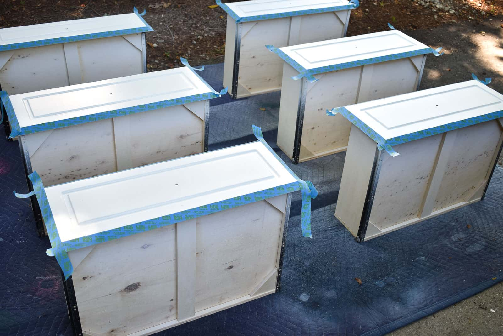 tape off the drawers and paint with three shades of blue for the ombre