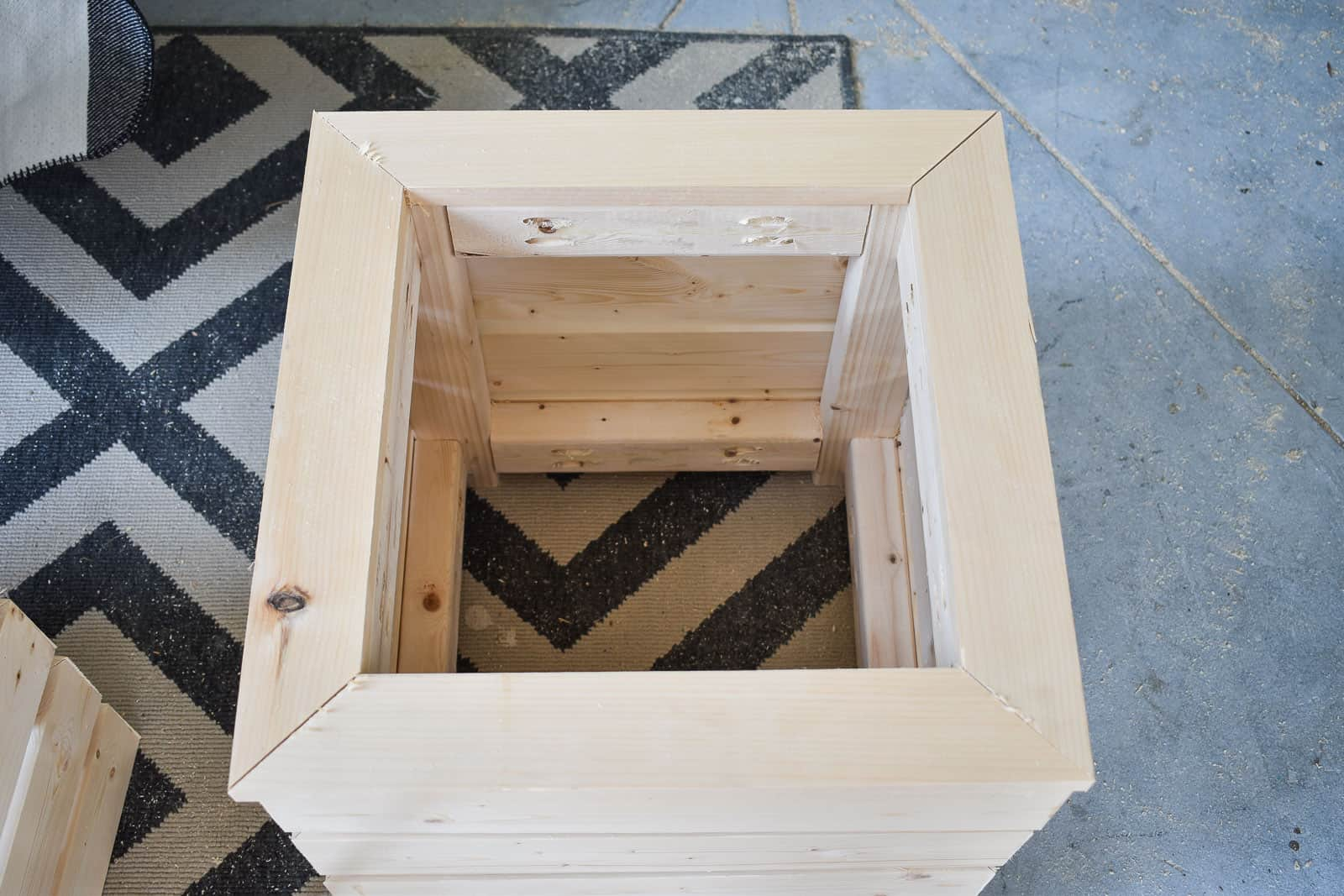 top of the planter with mitered wooden frame