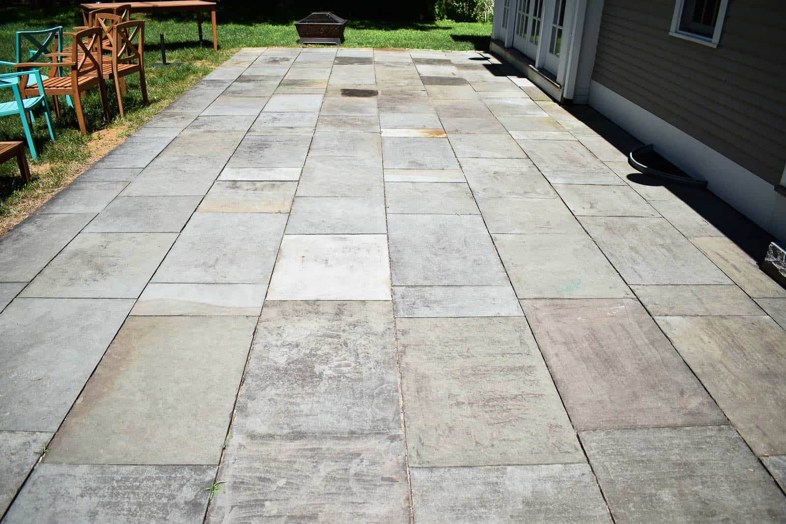 stone patio before pressure washing