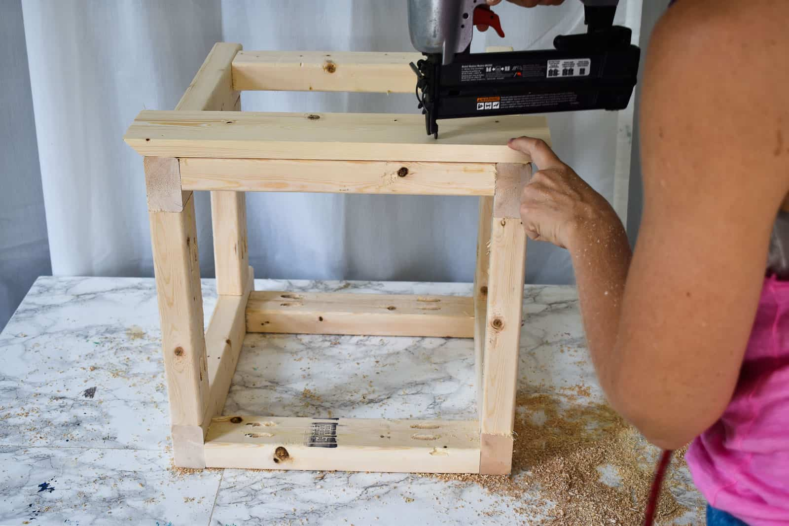 dry fit the slats and then attach with wood glue and brad nailer