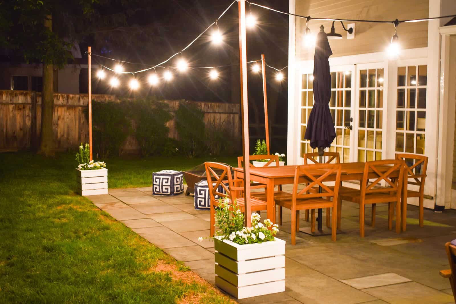 wooden planters with build in pole for hanging string lights