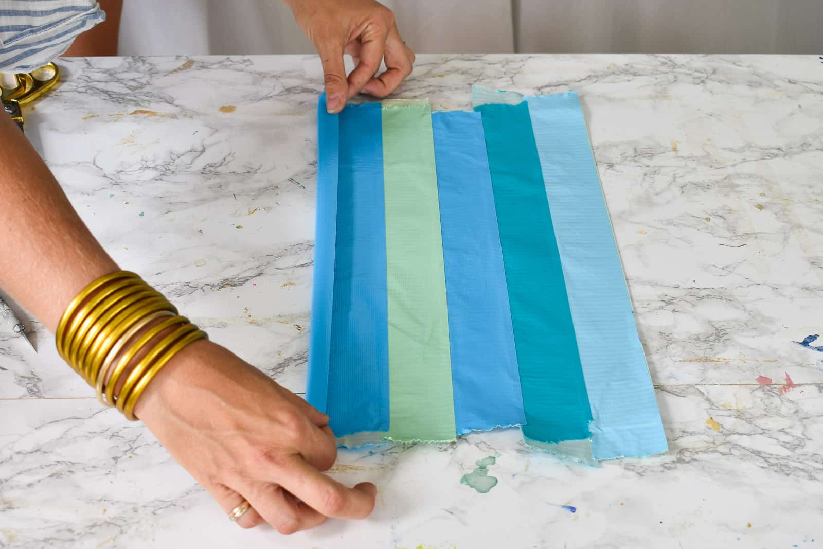 fold one length of duct tape around each side of sheet