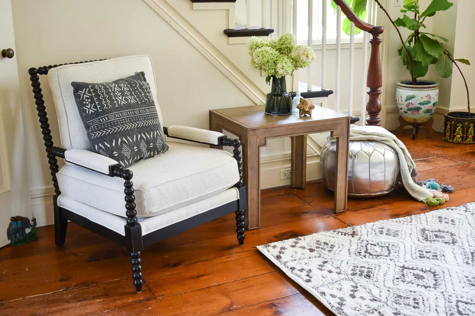 mudcloth pillow on spindle chair