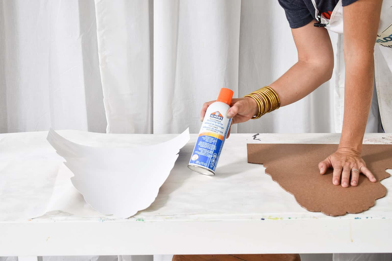 use spray adhesive to glue photo onto backing