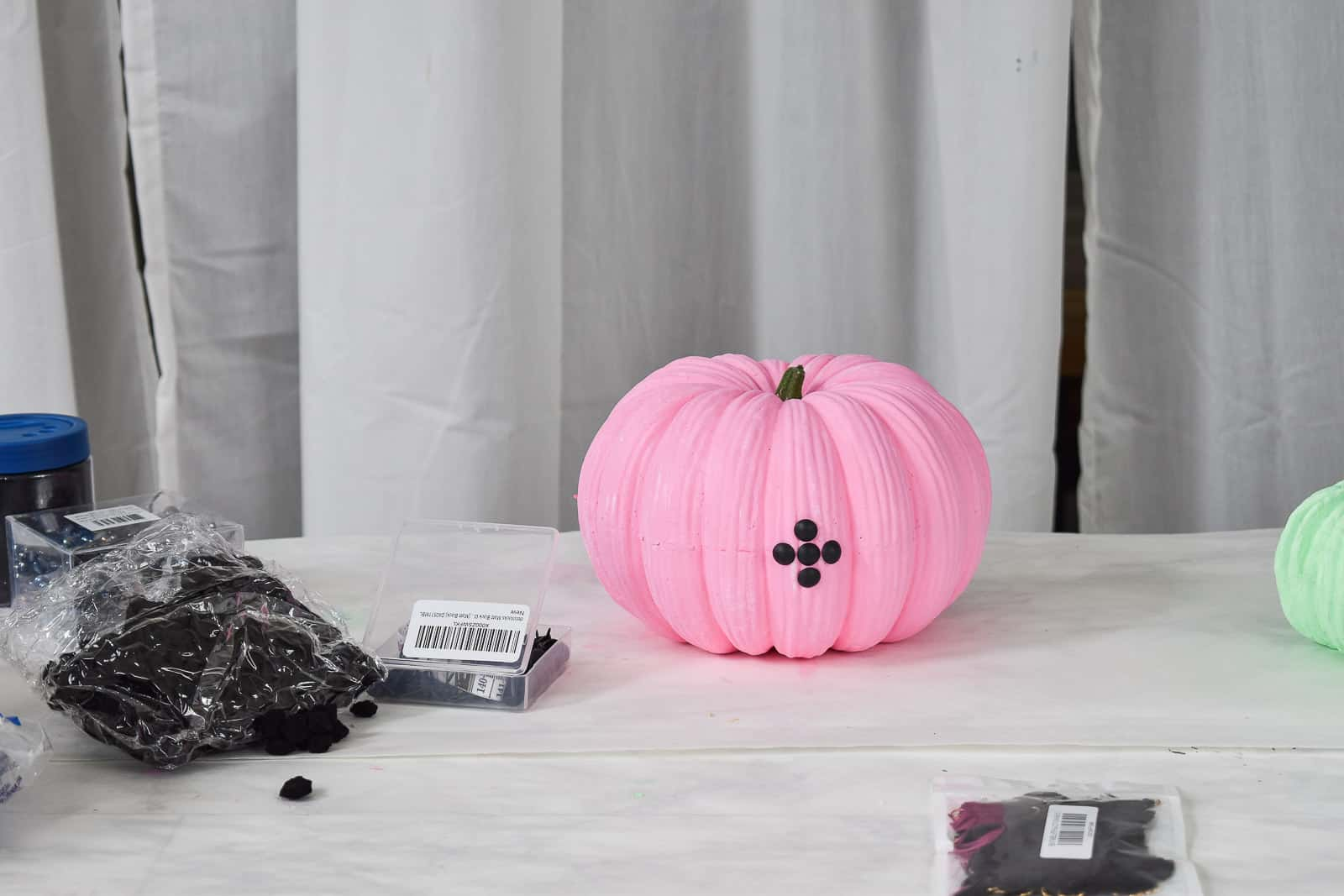 adding upholstery tacks to pumpkin