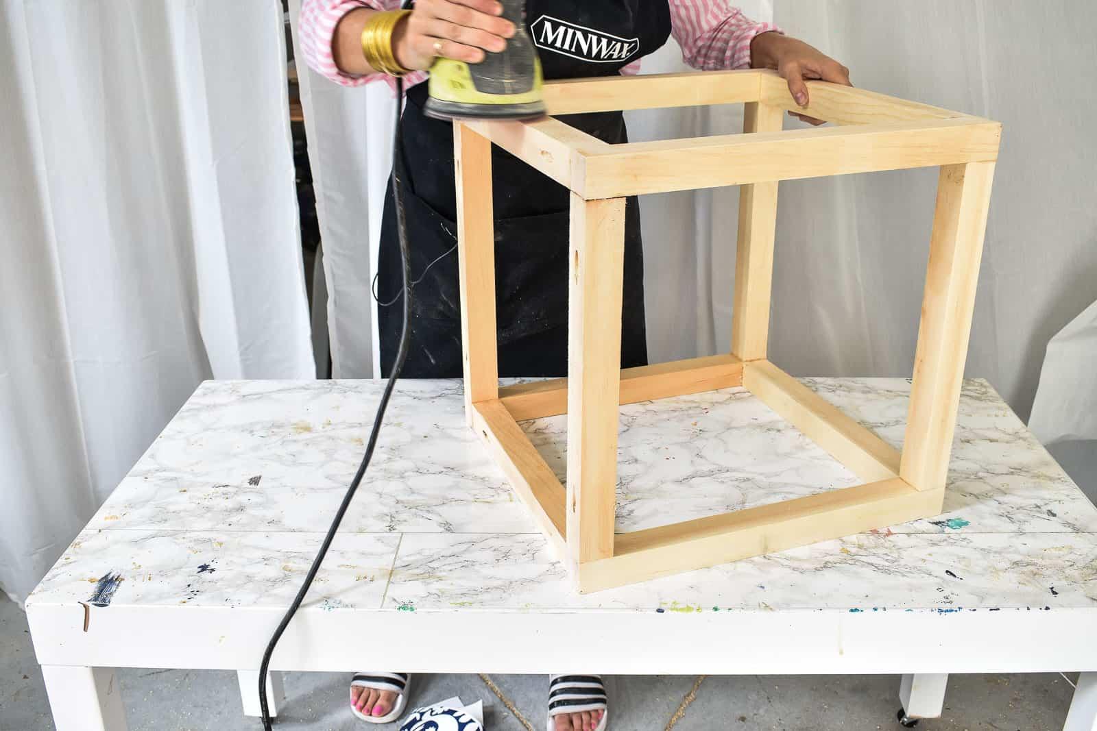 sand lumber before adding wallpaper
