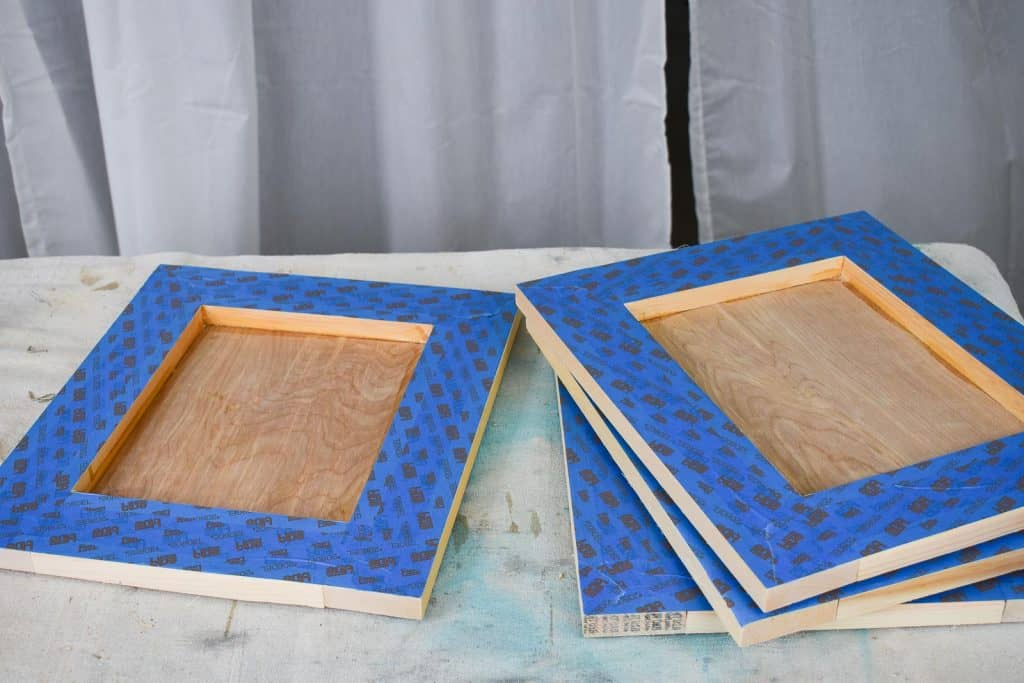 tape of top of wooden frame