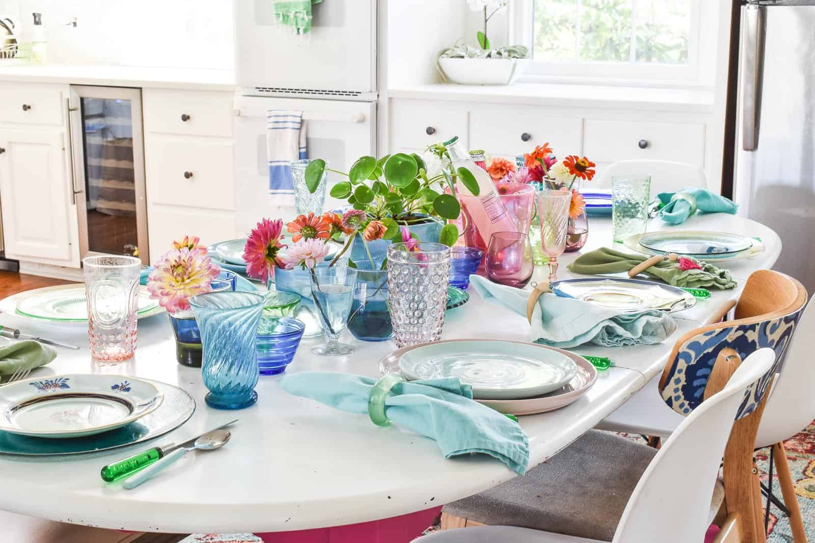 using rainbow glass to set a colorful table