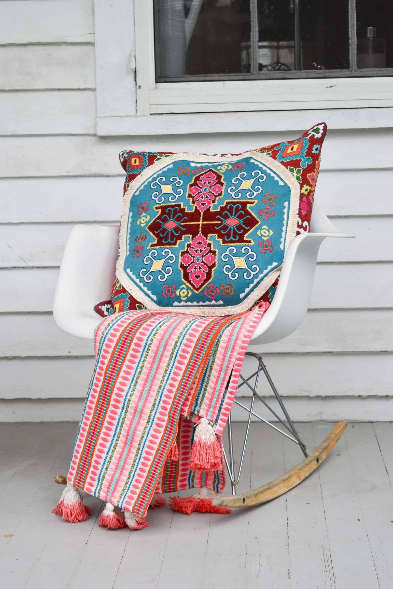 bright pillow on white chair