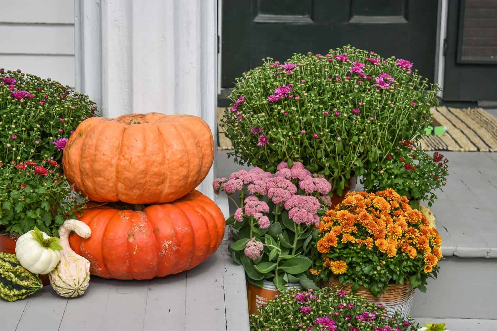 start with pumpkins on porch