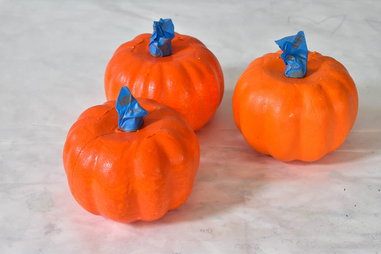 tape the stems of foam pumpkins