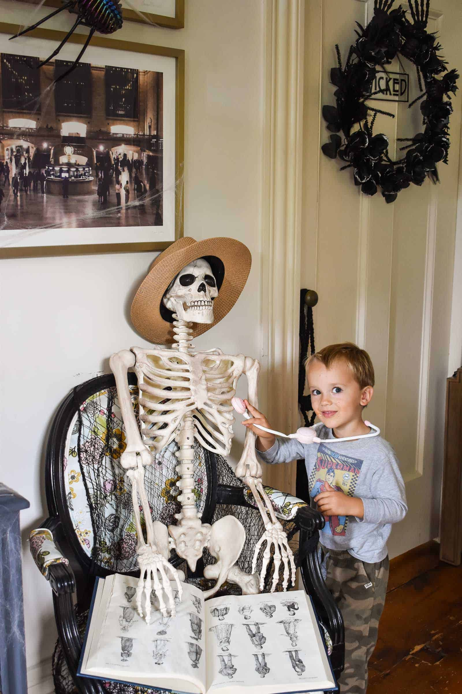 halloween skeleton posed as decoration