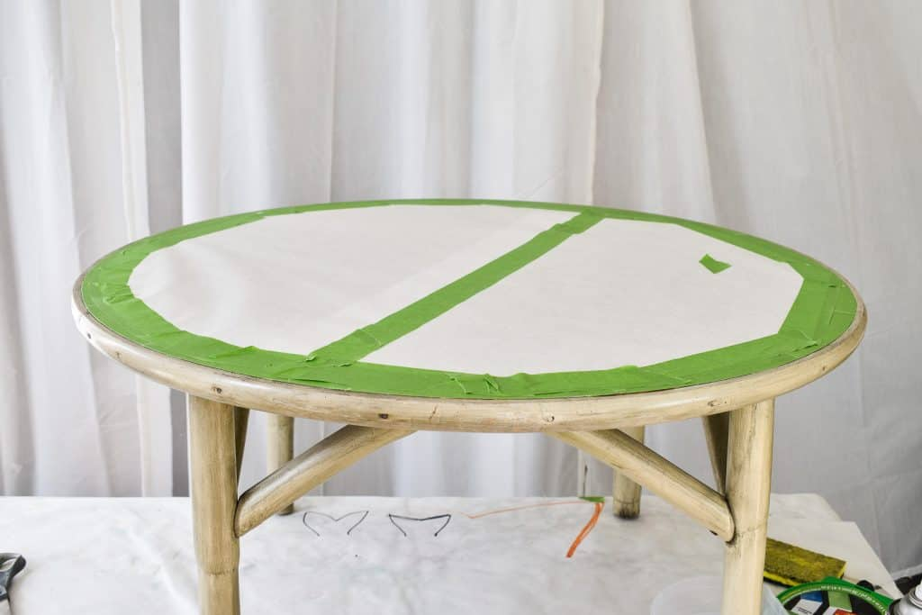 cover the table with white paper