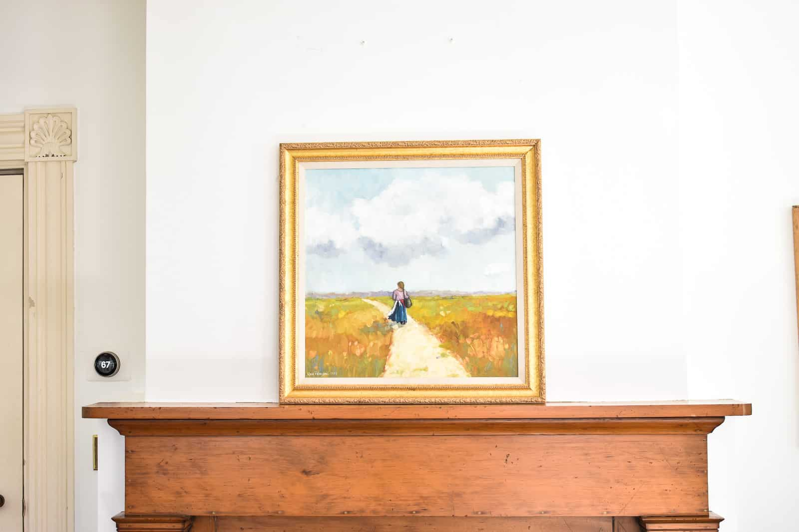 leaning artwork on the mantel