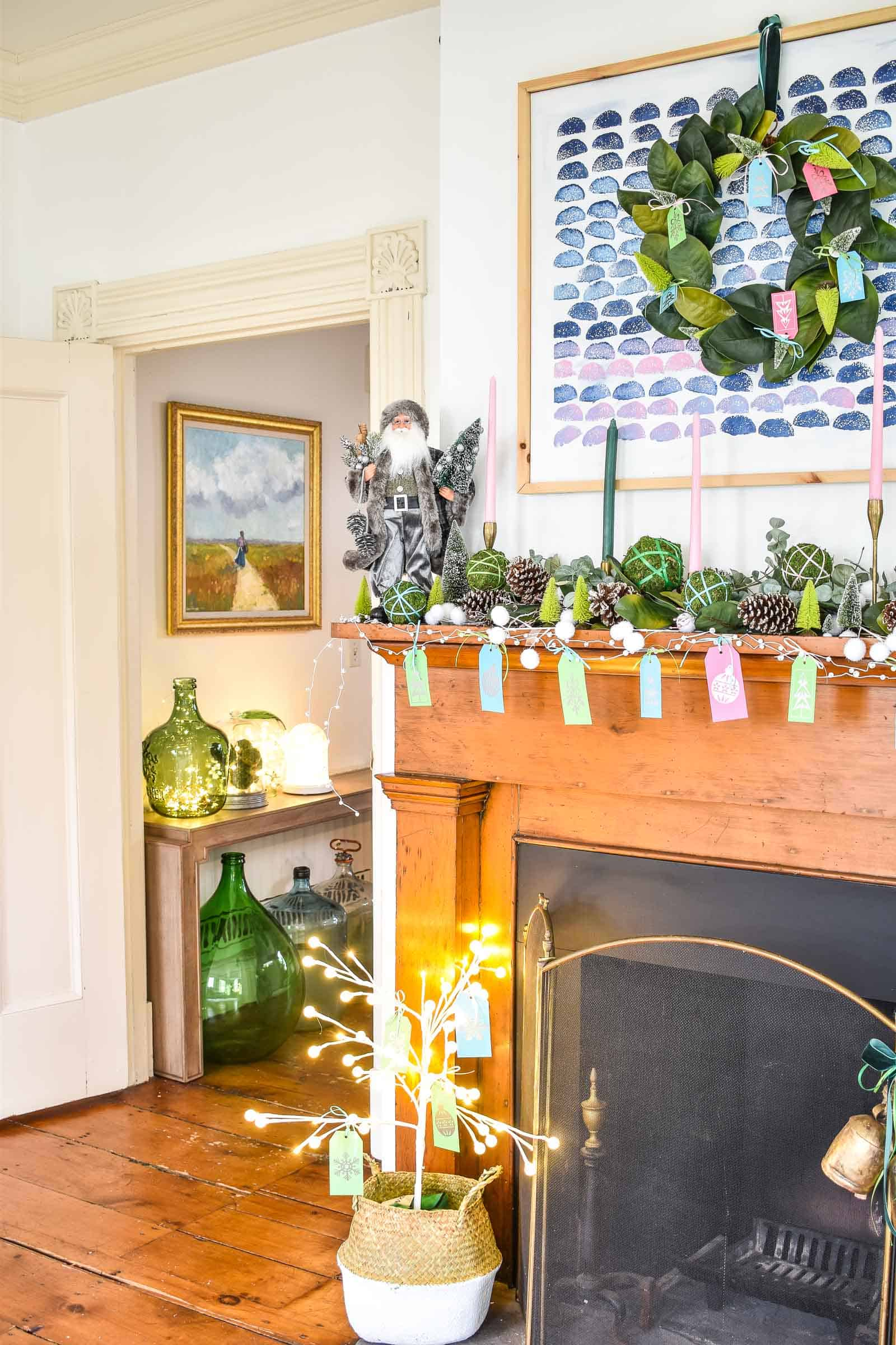 decorating a christmas mantel with greenery and color