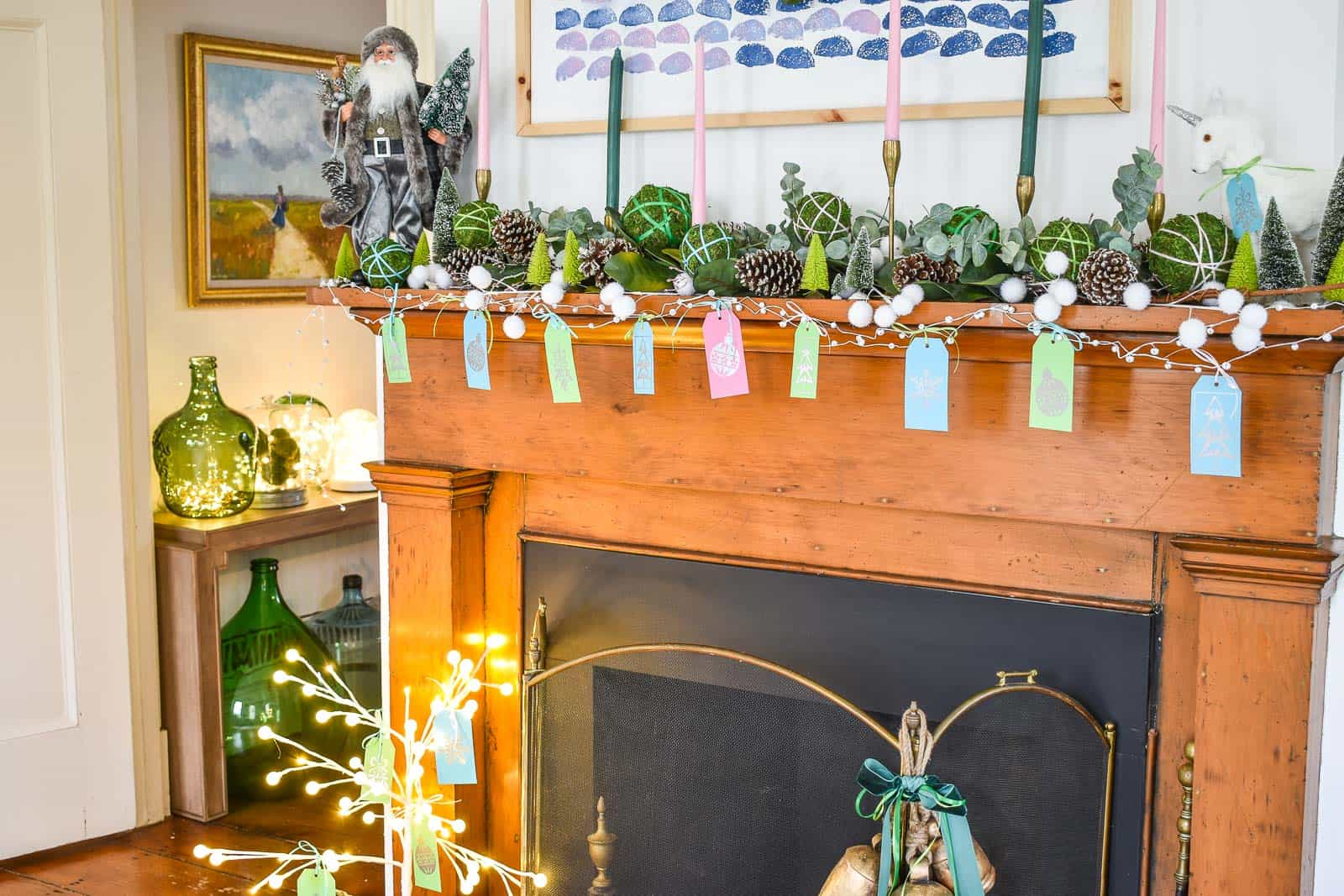 Fun christmas mantel with greenery and color