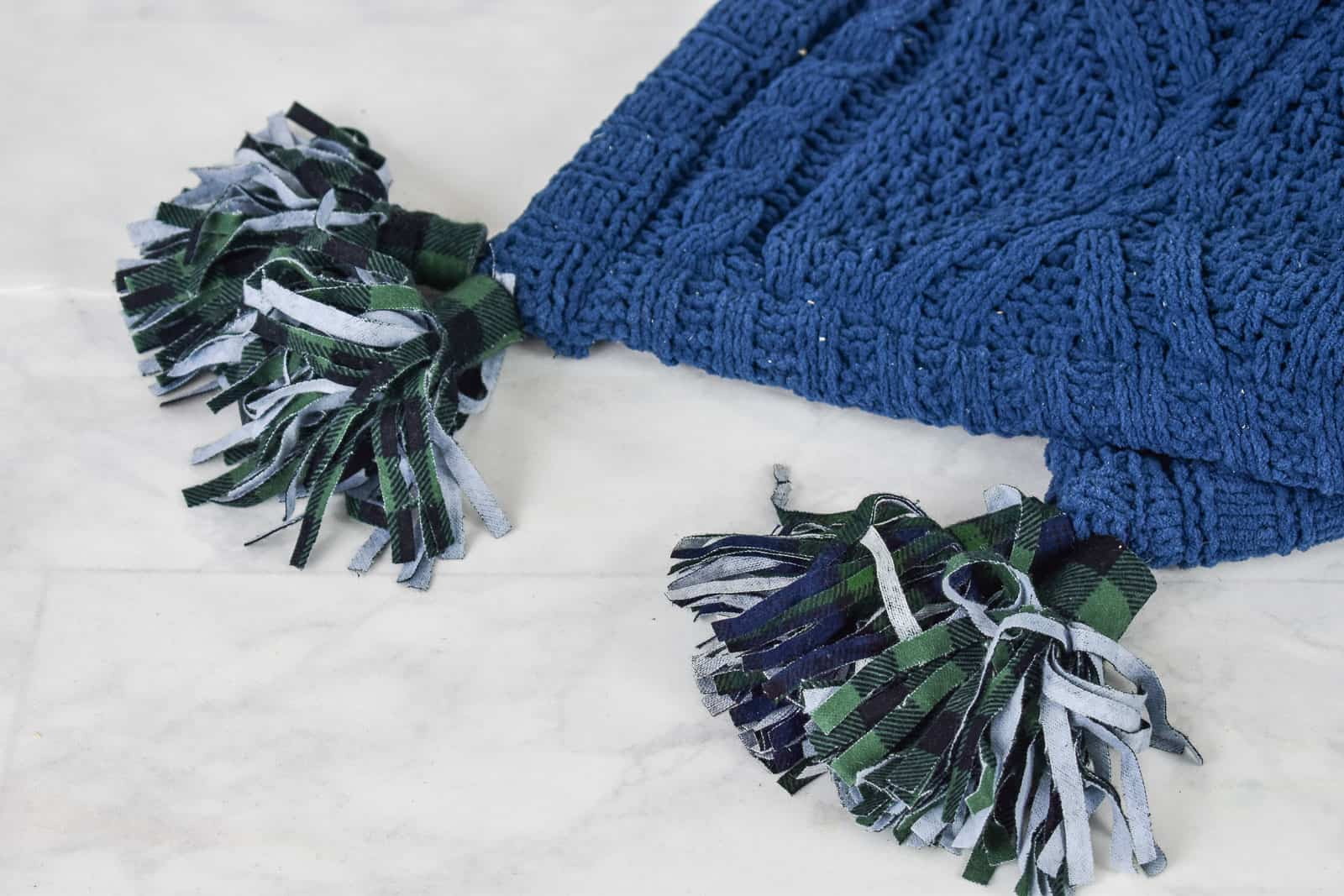 sew the tassels onto the blanket
