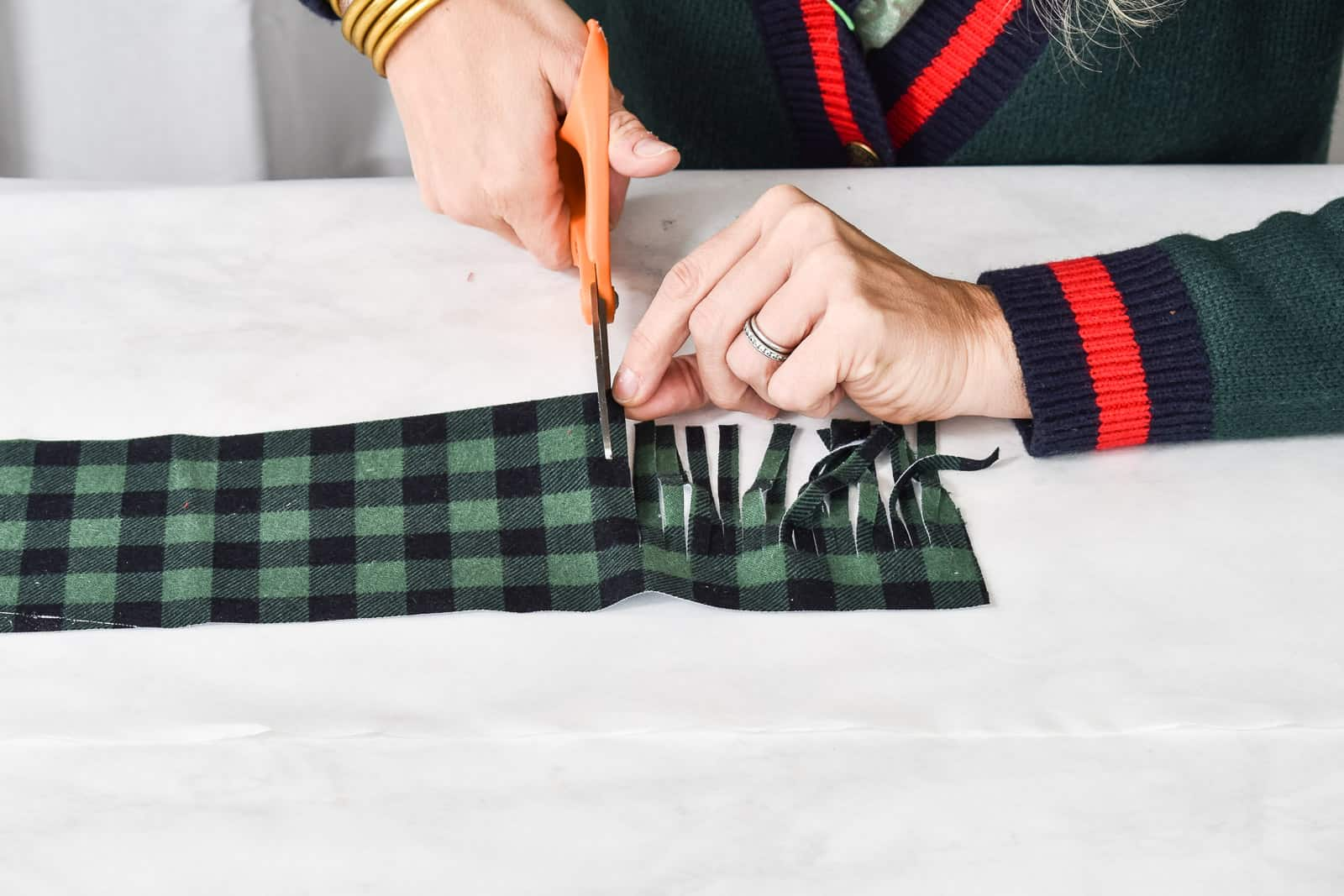 cut the fringe into the plaid fabric