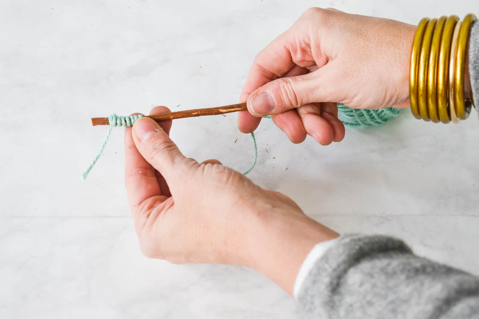 wrap the twine by twisting with one hand