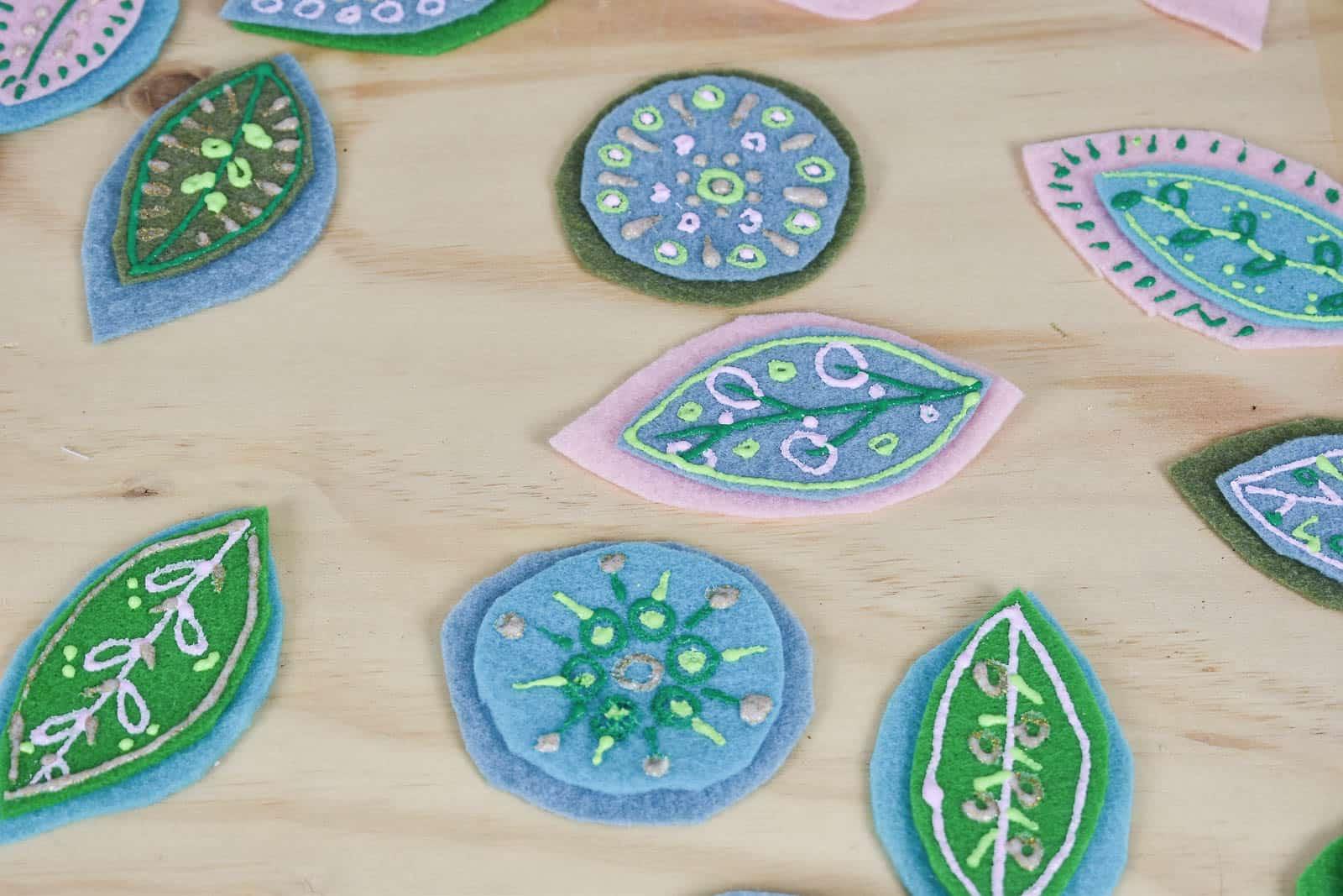 assemble floral felt shapes
