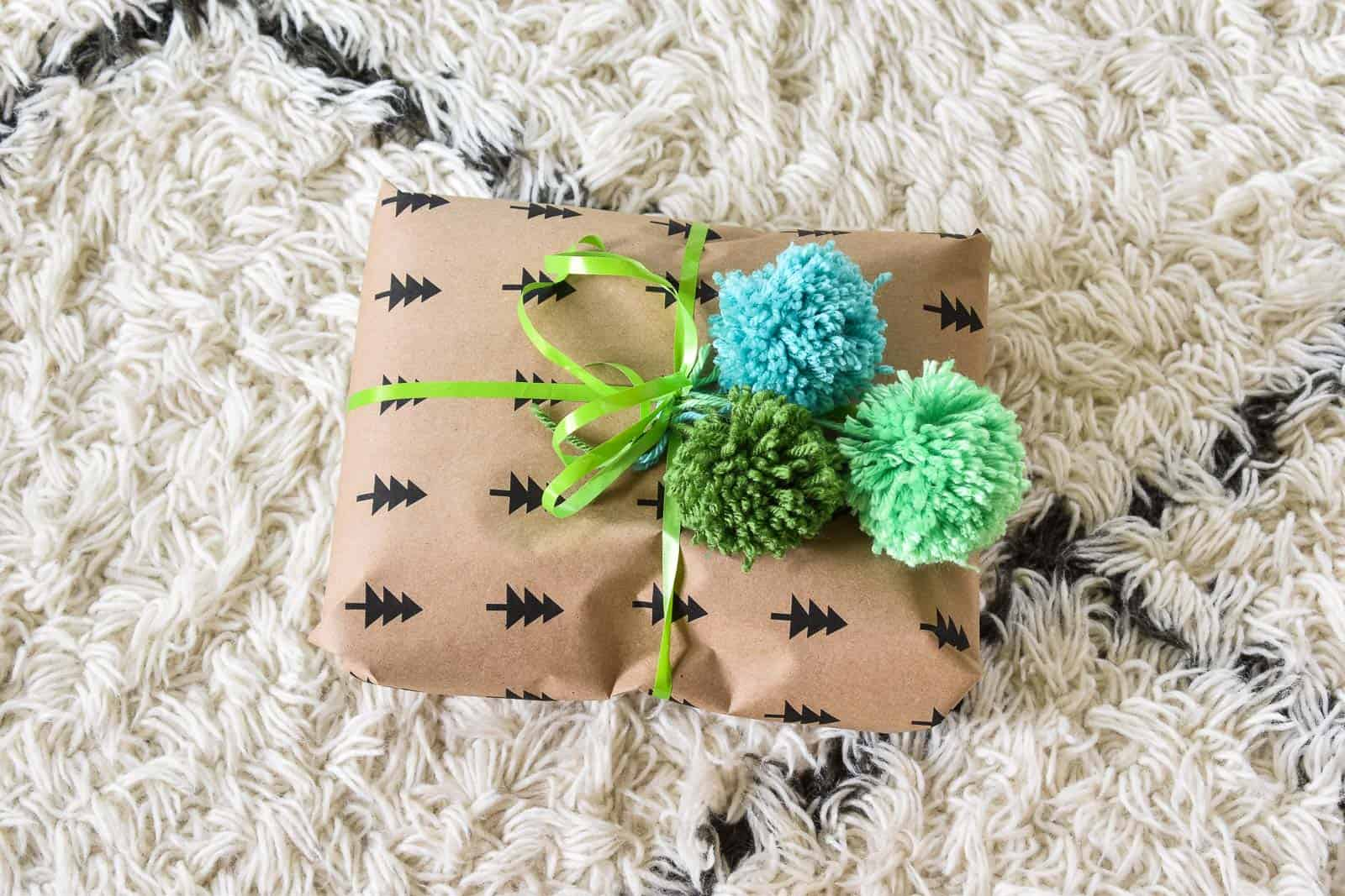 pom poms on wrapping paper