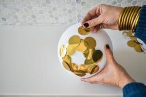 glue gold circles onto foam ball
