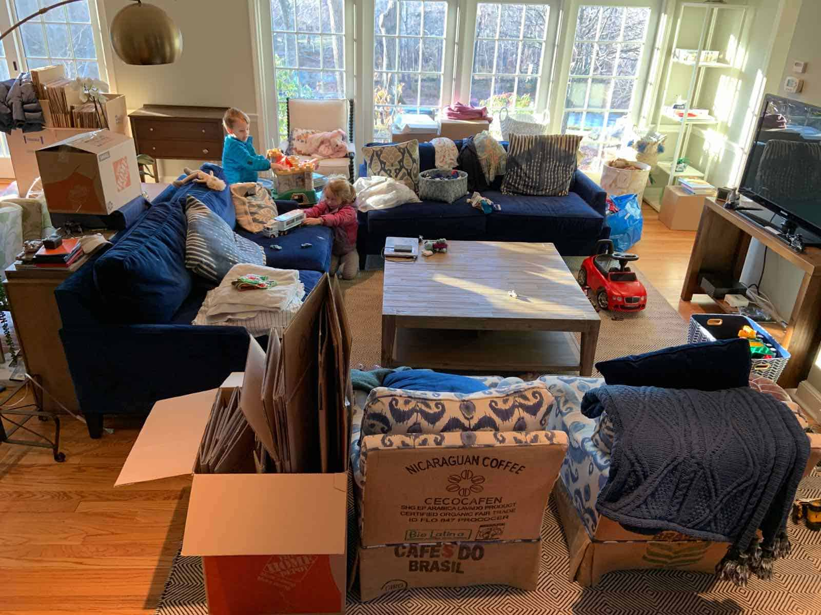 piles of boxes in family room