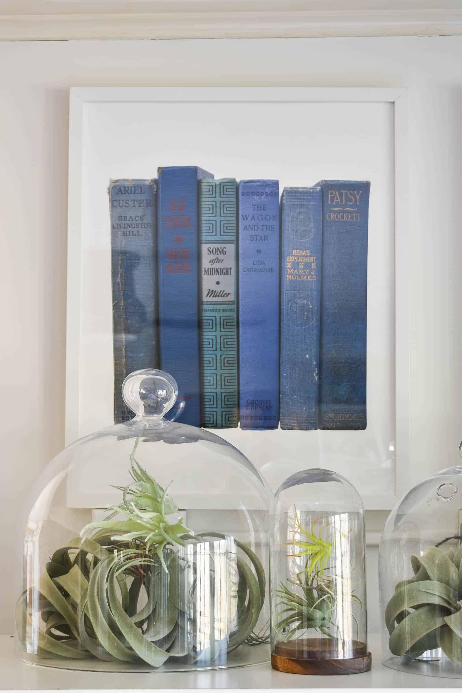 minted prints above storage shelf