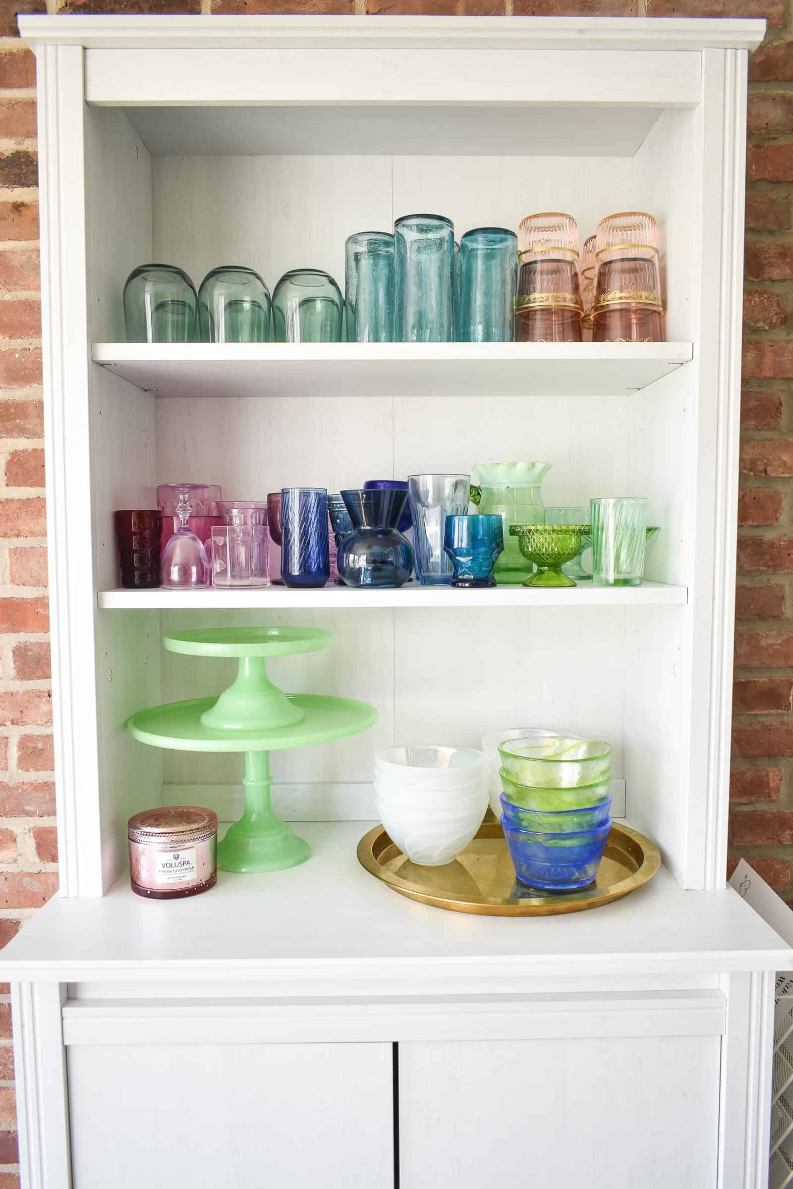 glassware on white shelf