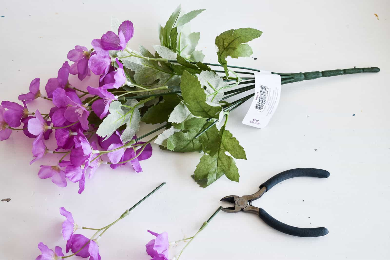 use wire cutter to cut flowers from arrangement
