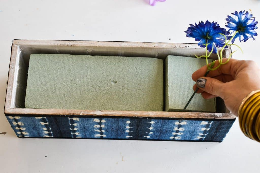 use floral foam inside the planters