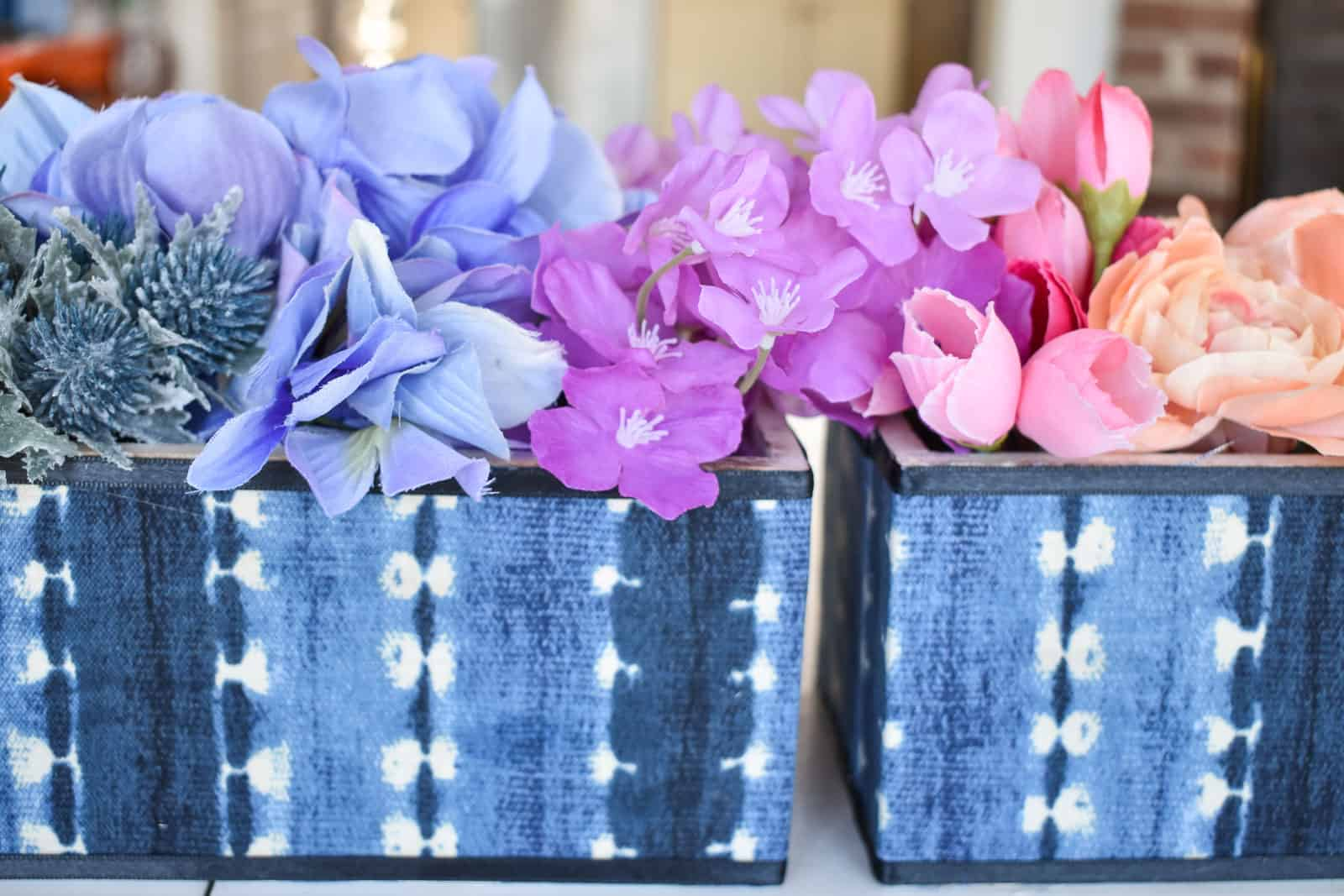 indigo planters with rainbow flower arrangement