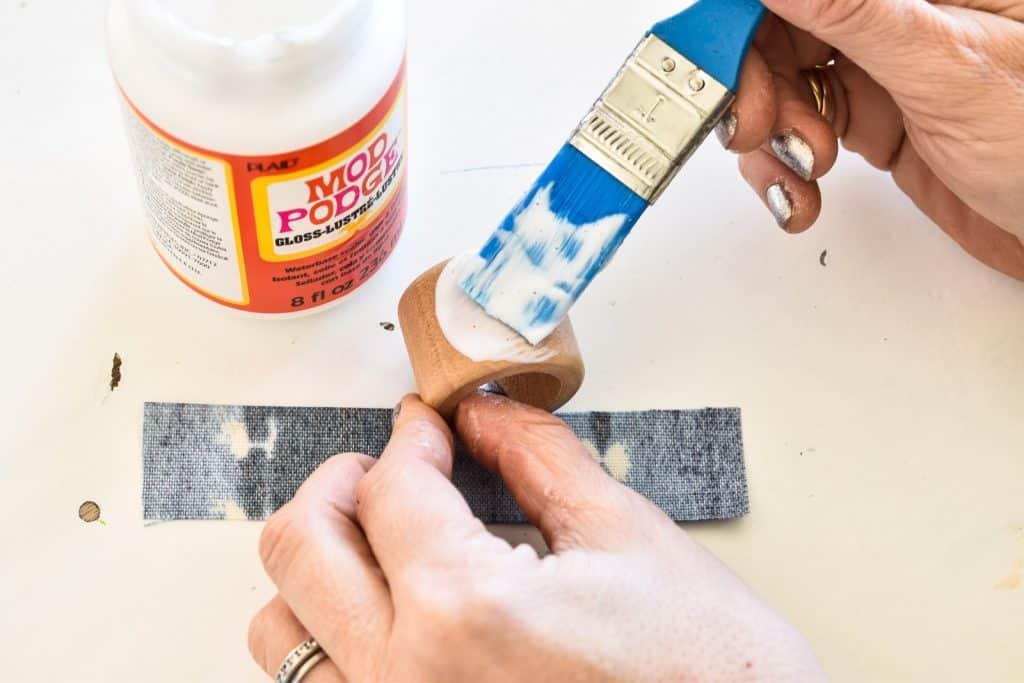 use mod podge to seal fabric onto napkin ring