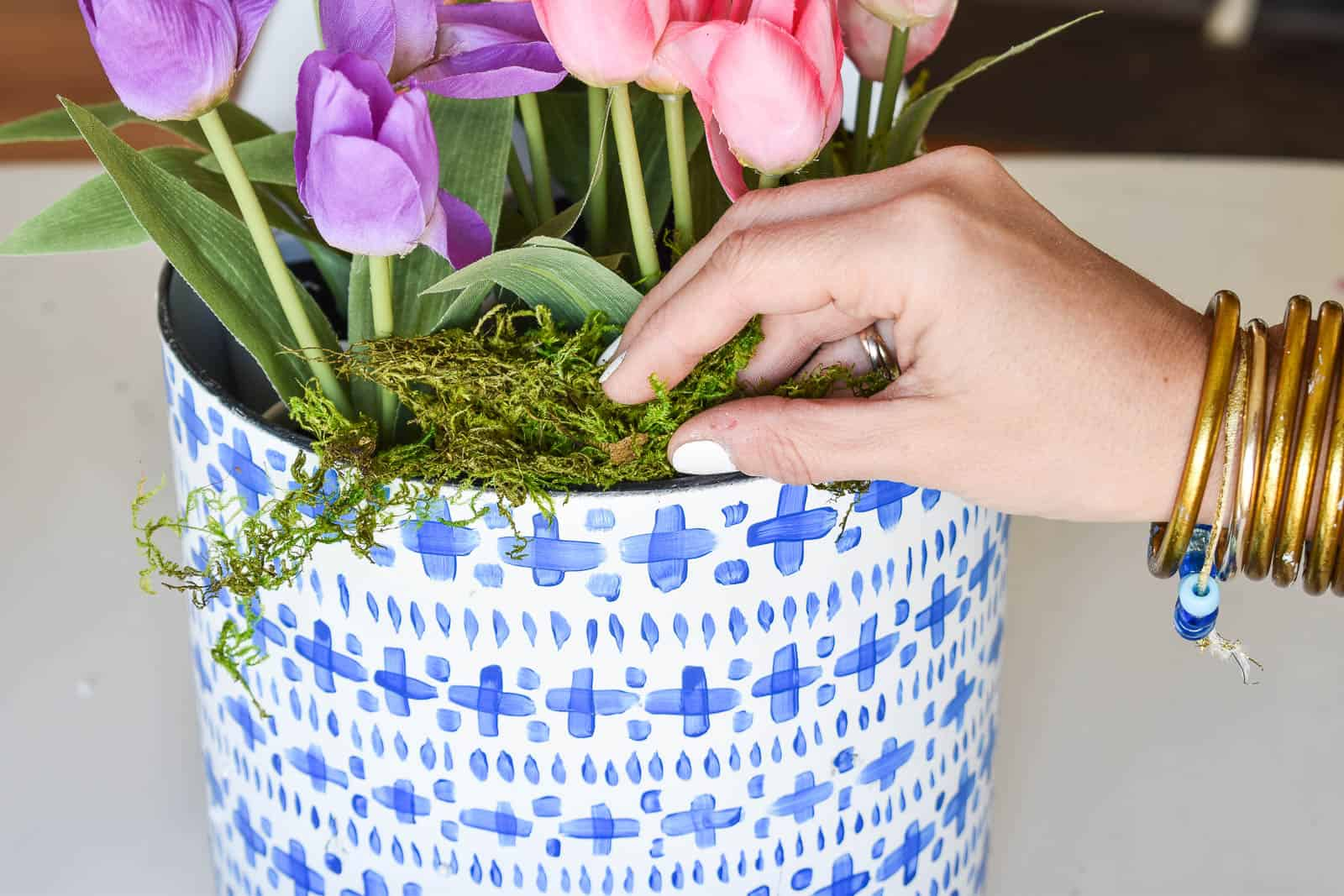 add moss to cover floral foam in planters