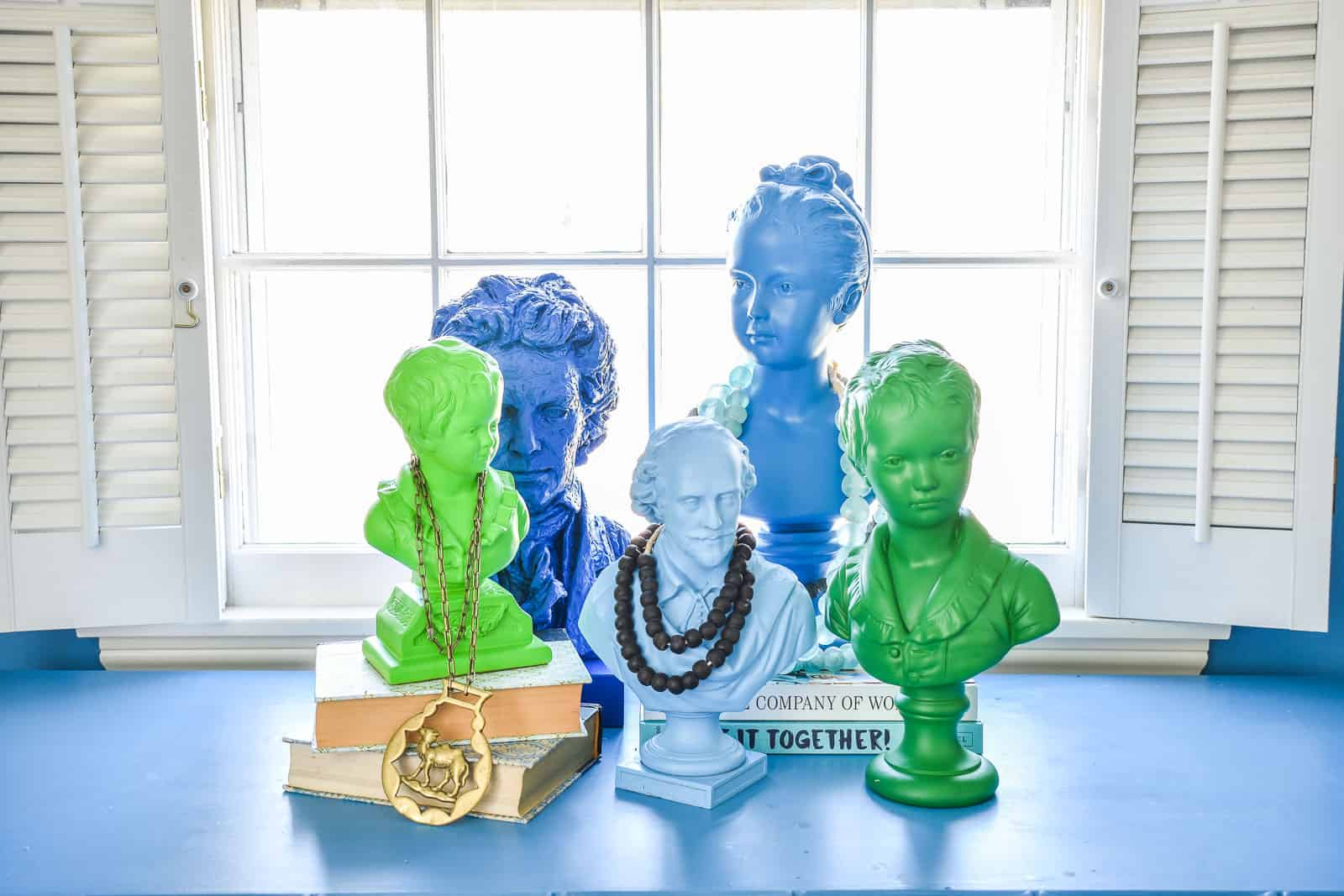 spray painted busts in office makeover