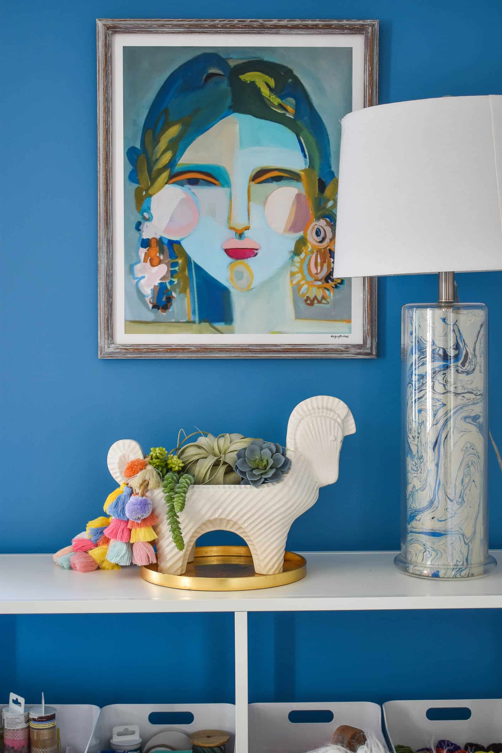 shelfie vignette in blue colorful office