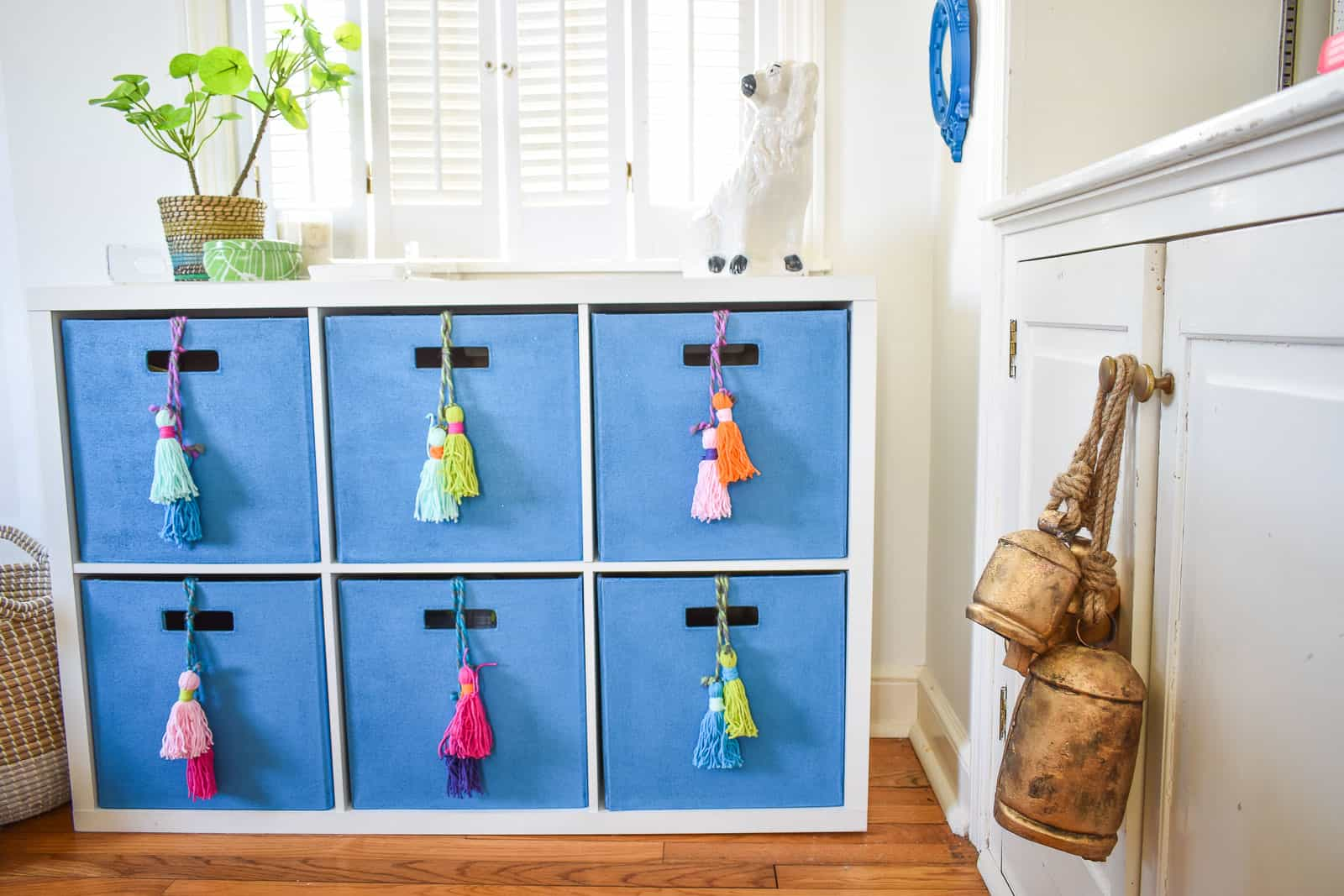 repainted storage bins with homemade tassels