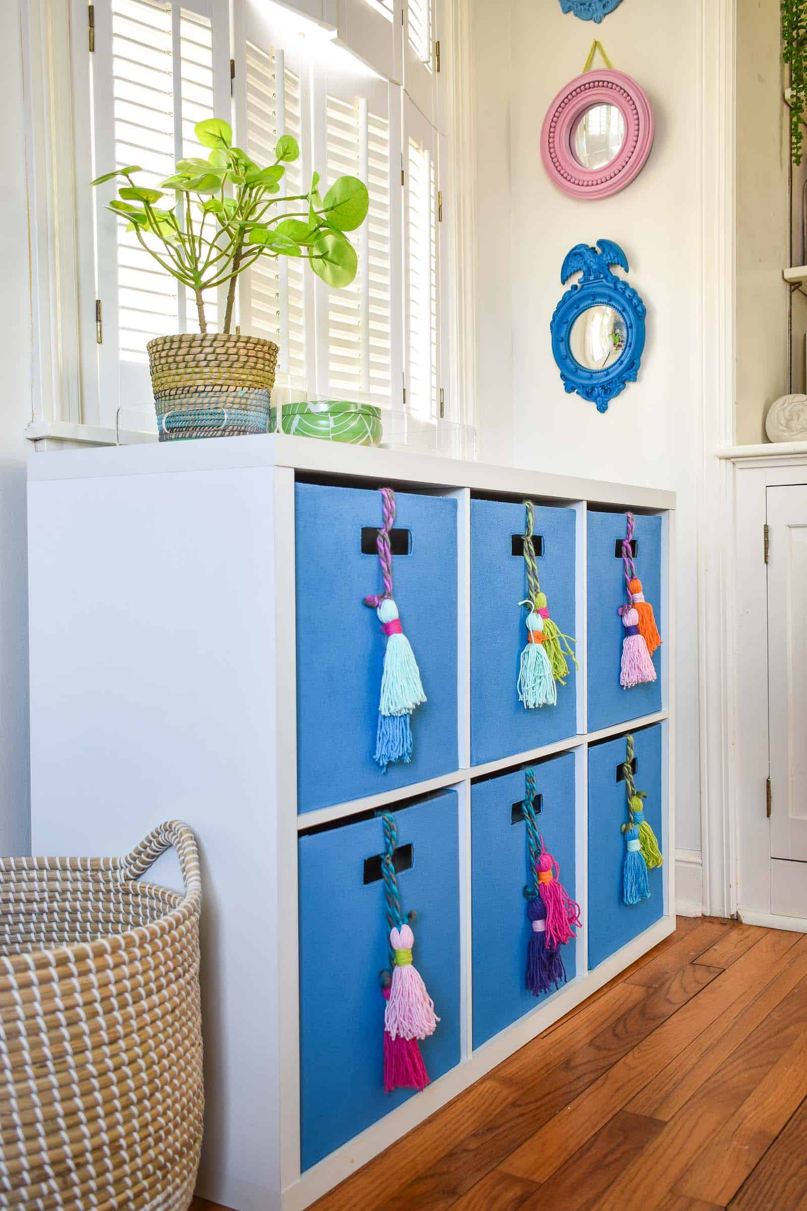 colorful blue storage cubes with DIY tassels