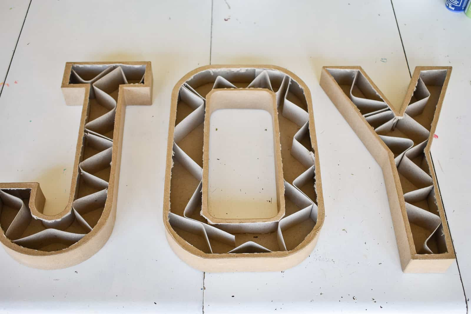 remove inside cardboard of paper mache letters