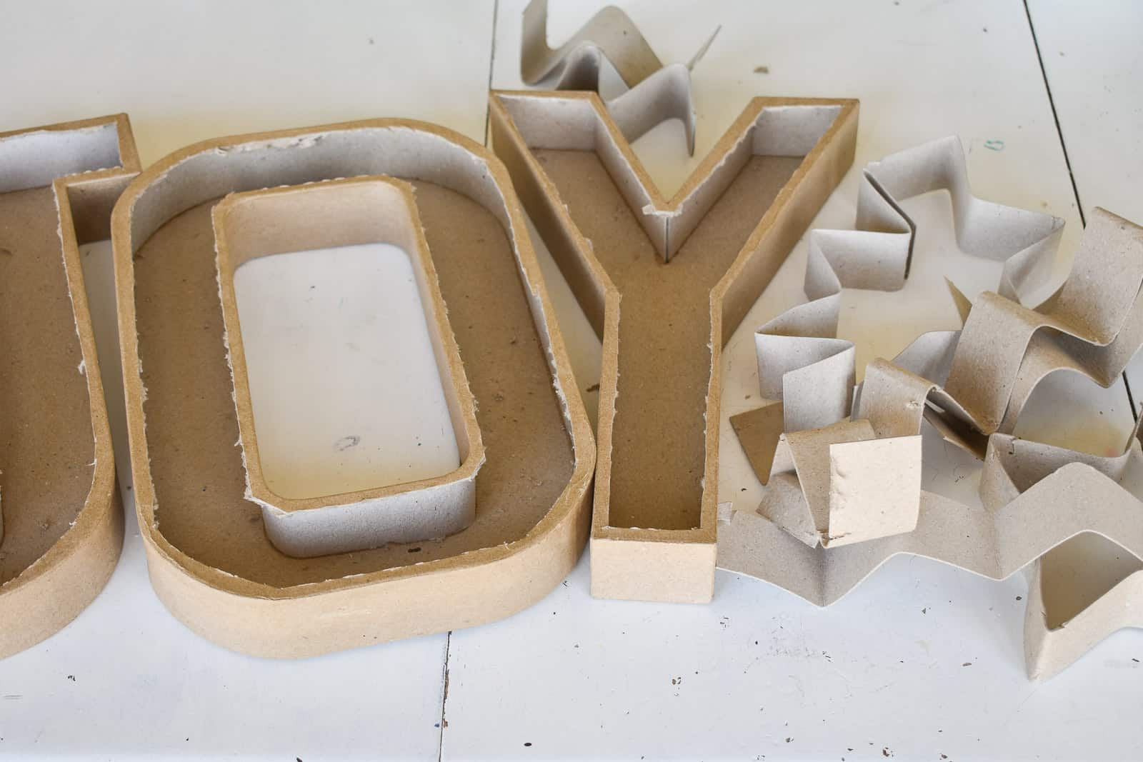 cut open the paper mache letters