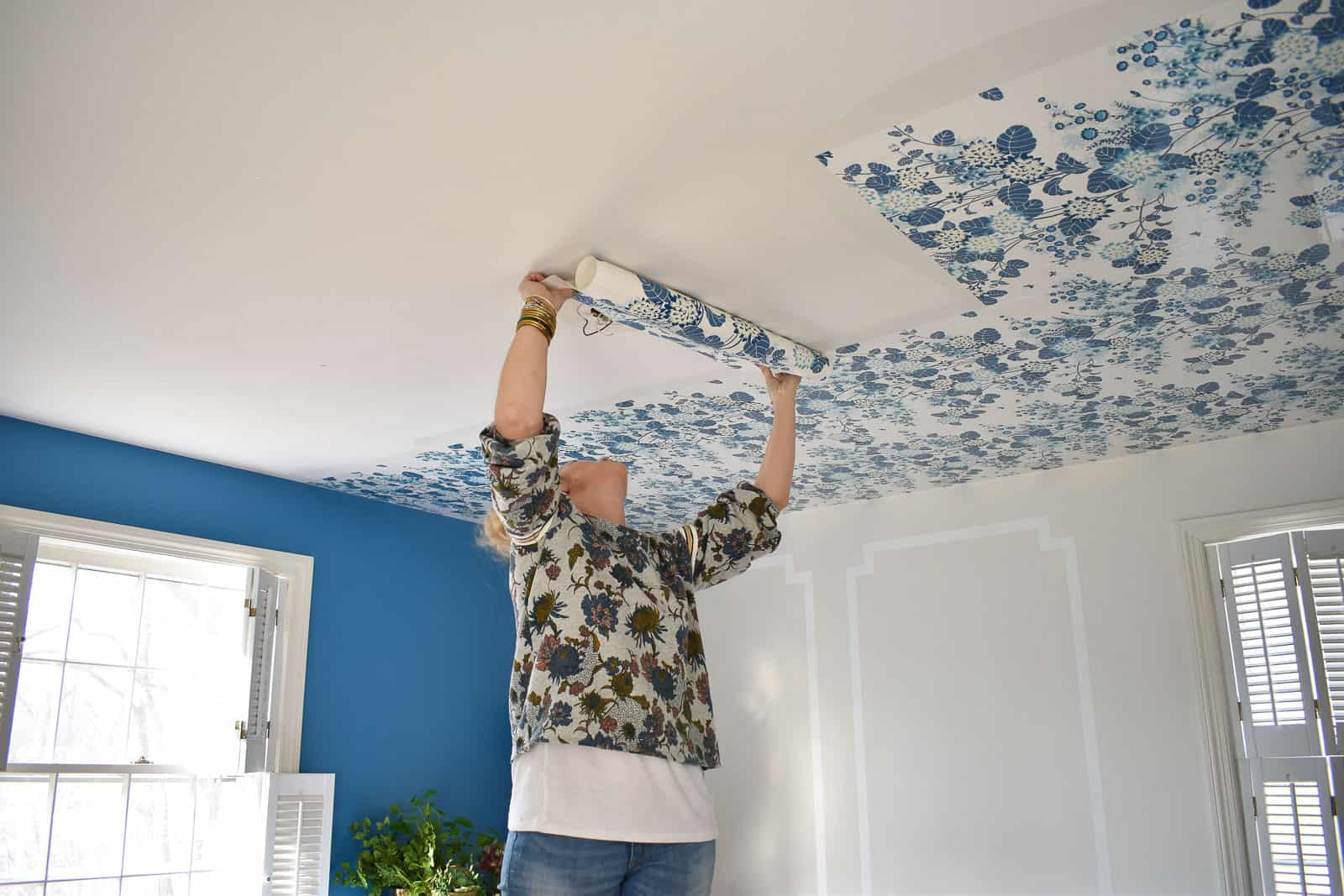 hanging wallpaper on the ceiling