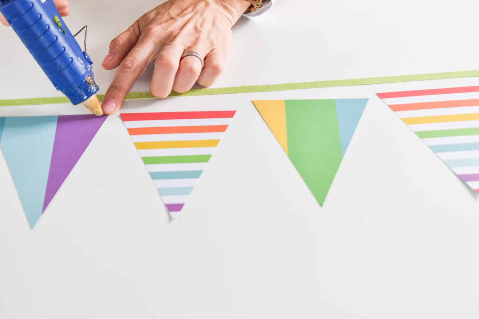 glue triangles onto ribbon for pennant