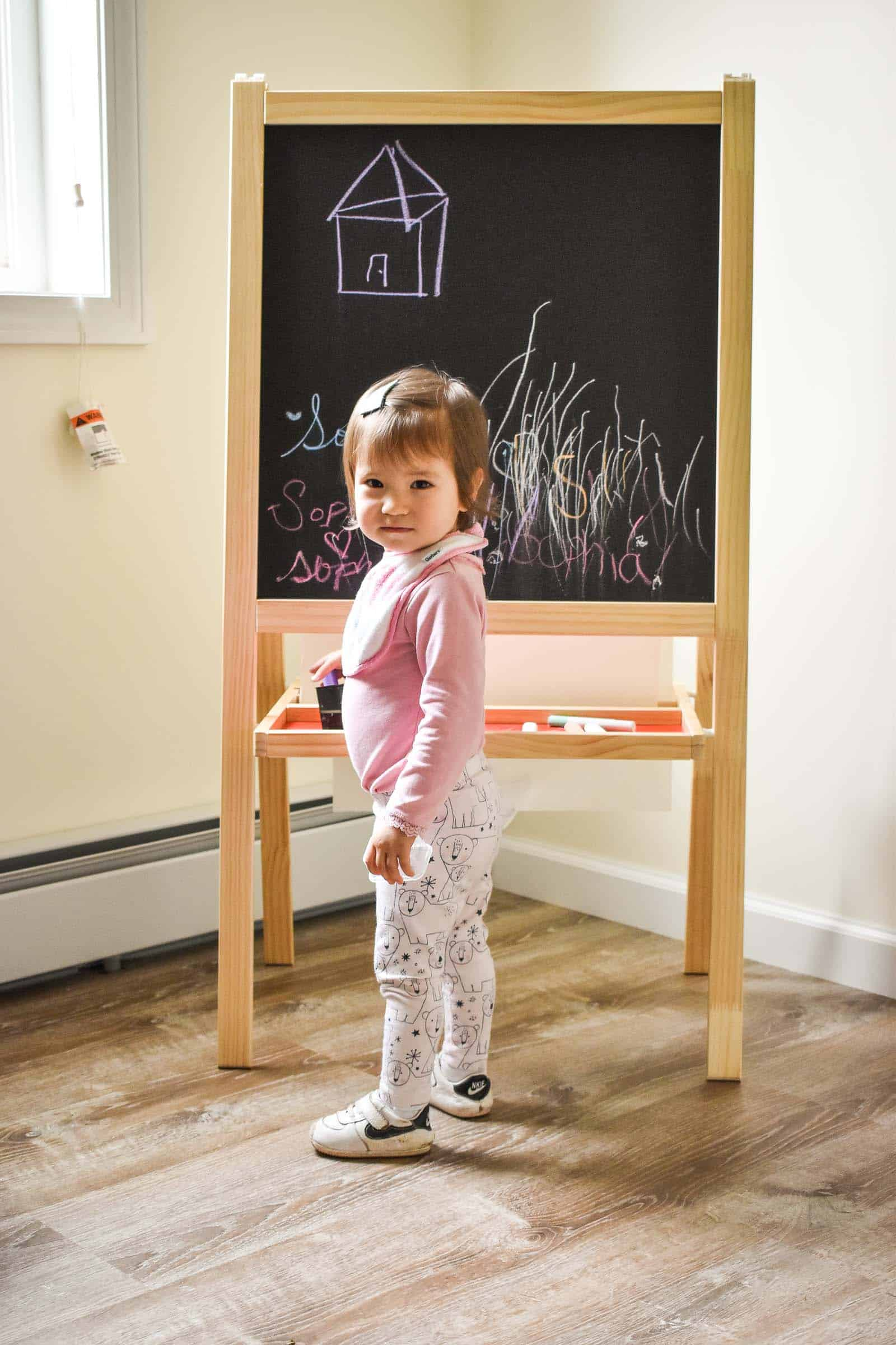little girl enjoying the easel