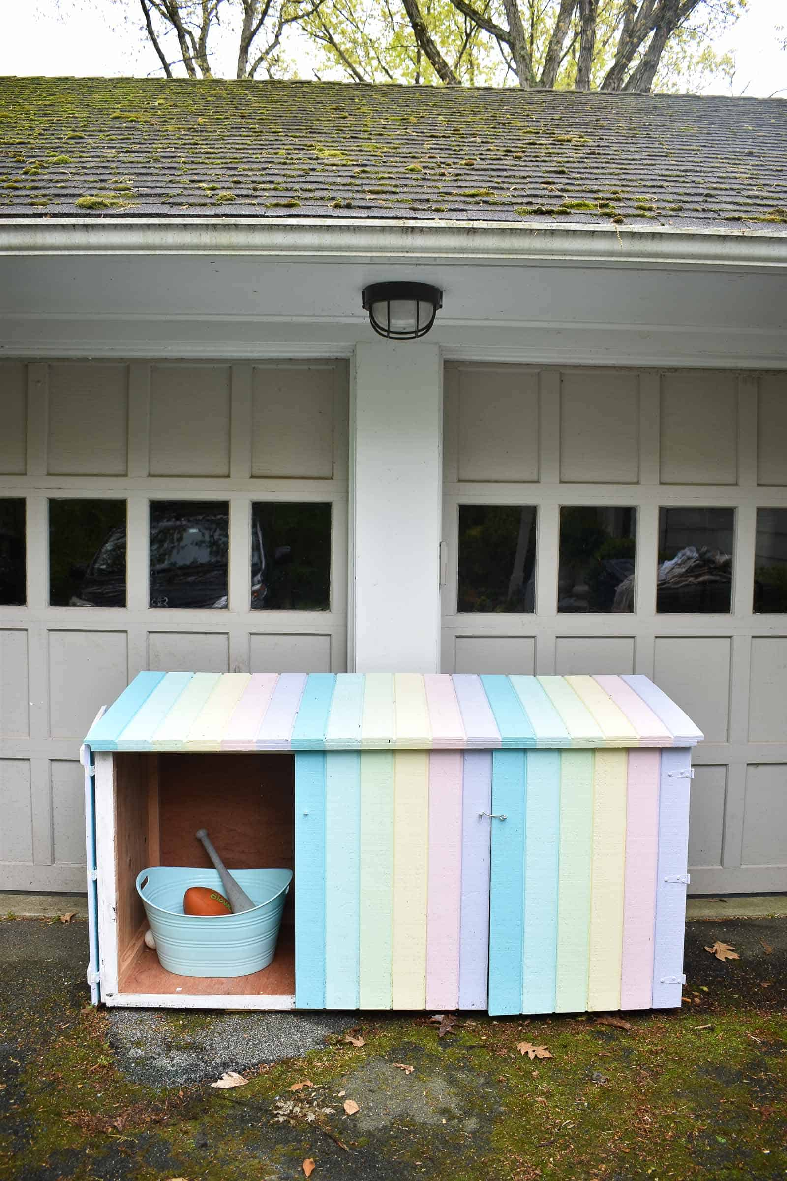 cleaning up toys with a trash can shed