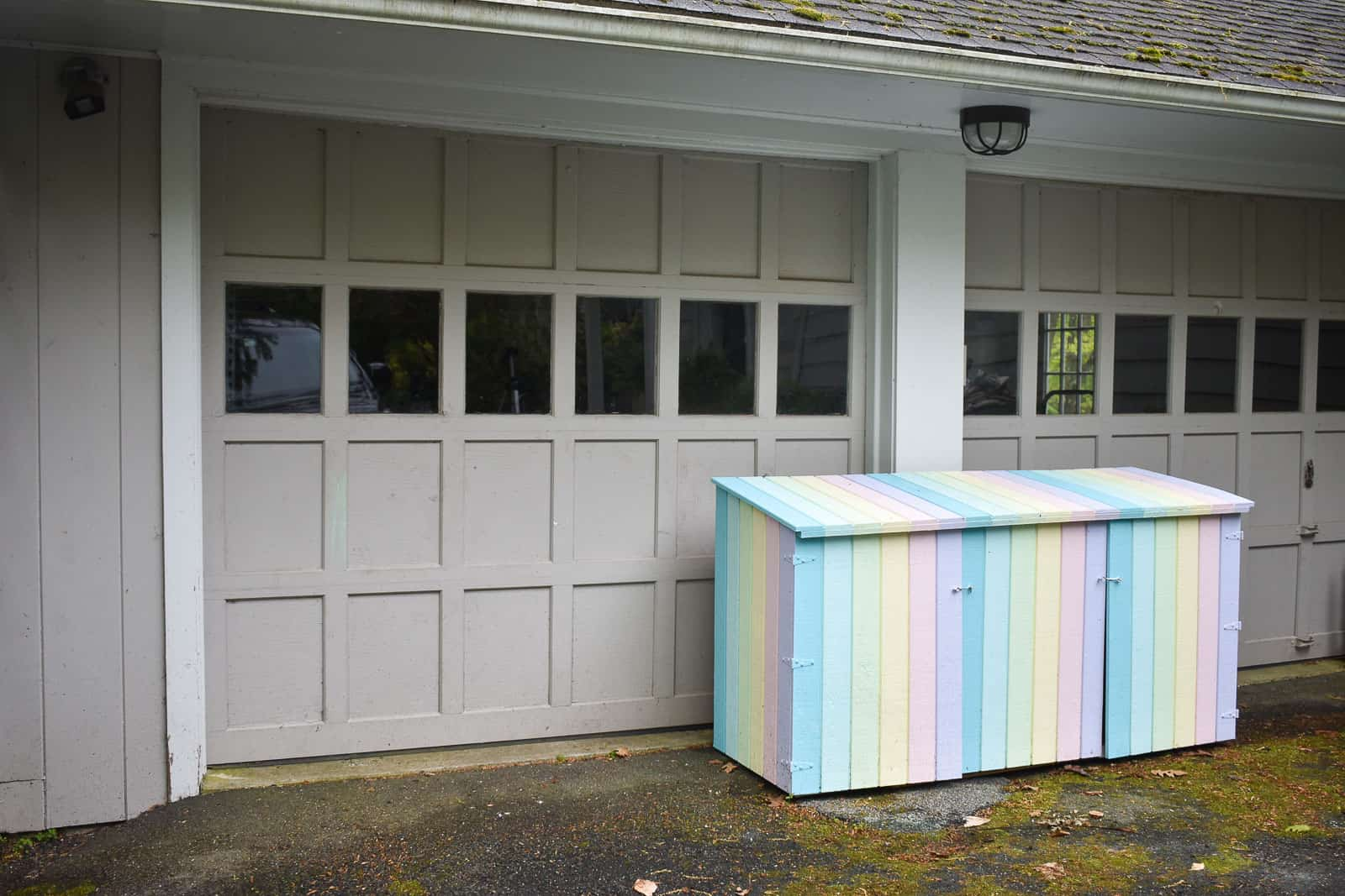 rainbow colored trash can shed