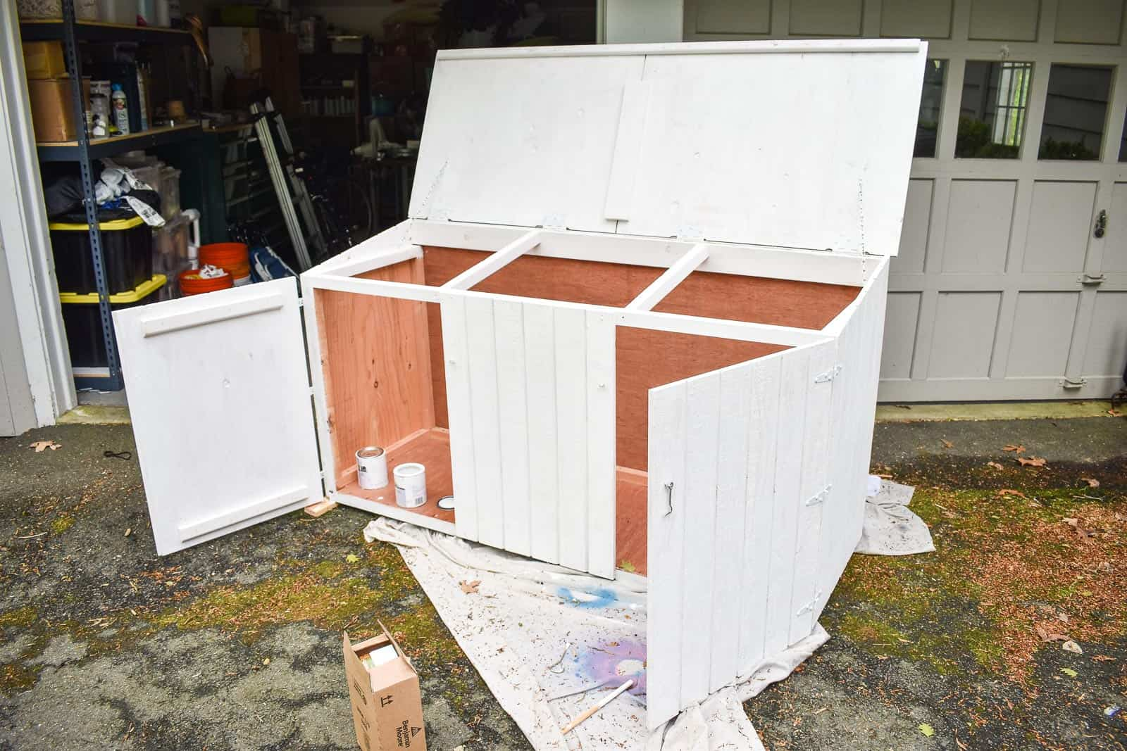 primed trash can shed